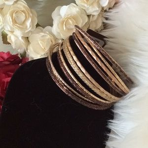 NWT.  Brown and gold bangles.